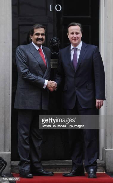 Prime Minister David Cameron greets the Emir of Qatar Sheikh Hamad bin Khalifa Al Thani at 10 Downing Street London
