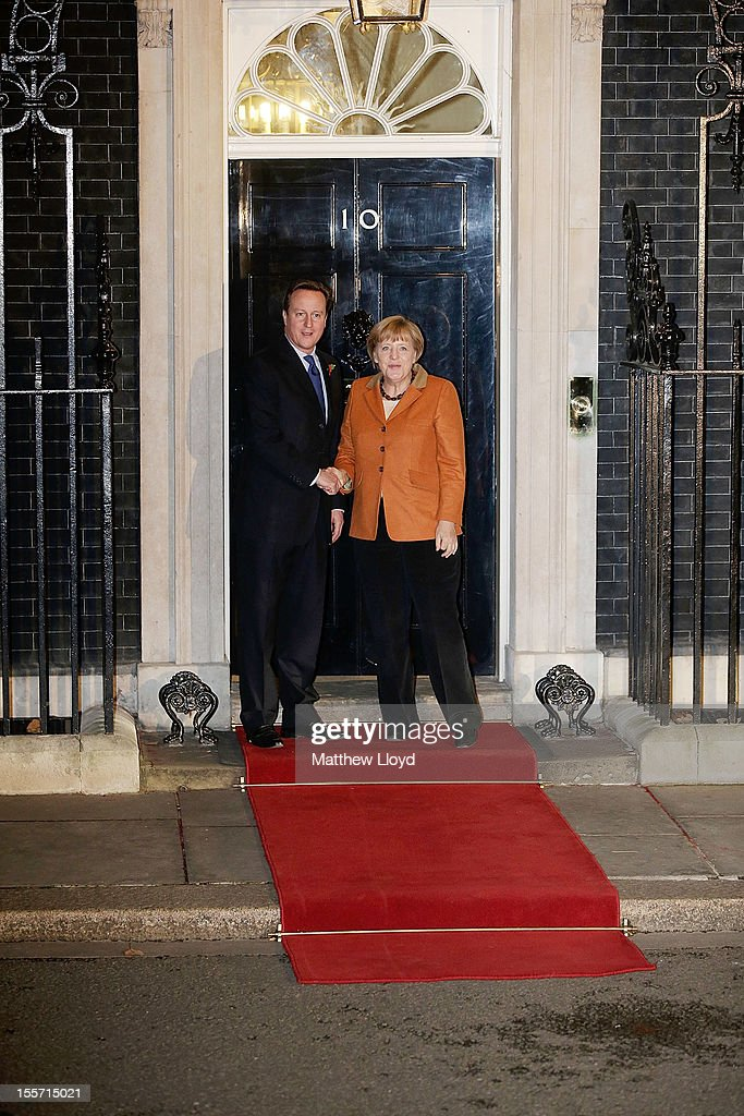 Prime Minister <a gi-track='captionPersonalityLinkClicked' href=/galleries/search?phrase=David+Cameron+-+Politician&family=editorial&specificpeople=227076 ng-click='$event.stopPropagation()'>David Cameron</a> greets the German Chancellor <a gi-track='captionPersonalityLinkClicked' href=/galleries/search?phrase=Angela+Merkel&family=editorial&specificpeople=202161 ng-click='$event.stopPropagation()'>Angela Merkel</a> at 10 Downing Street on November 7, 2012 in London, England. The two leaders will discuss EU parliament budgets and increased fiscal powers over its members.