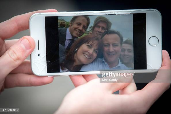 Prime Minister David Cameron has a selfie taken with supporters outside the village hall in Norton Sub Hamdon in the Yeovil constituency on April 26...