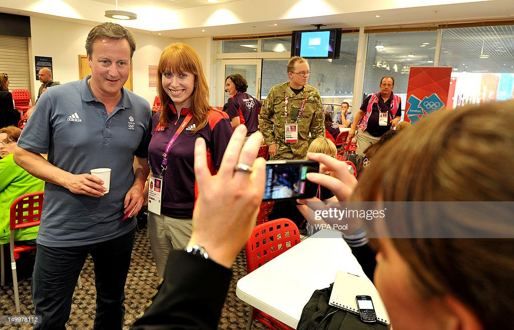 Prime Minister <a gi-track='captionPersonalityLinkClicked' href=/galleries/search?phrase=David+Cameron+-+Politician&family=editorial&specificpeople=227076 ng-click='$event.stopPropagation()'>David Cameron</a> has his photo taken with an Olympic volunteer, as he met some of the huge volunteer workforce at the ExcCel venue in Docklands on Day 12 of the London 2012 Olympic Games on August 8, 2012 in London, England.