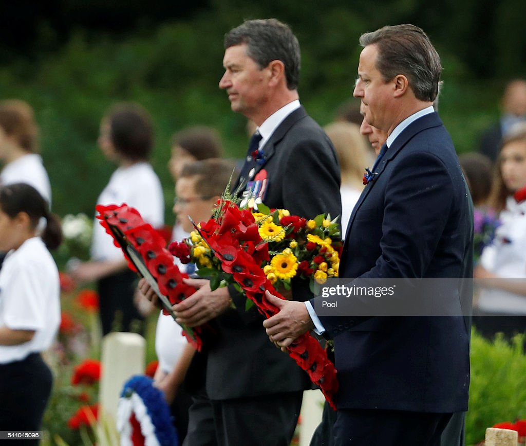 Prime Minister <a gi-track='captionPersonalityLinkClicked' href=/galleries/search?phrase=David+Cameron+-+Politician&family=editorial&specificpeople=227076 ng-click='$event.stopPropagation()'>David Cameron</a> holds a wreath during the 100th anniversary of the beginning of the Battle of the Somme at the Thiepval memorial to the Missing on July 1, 2016 in Thiepval, France. The event is part of the Commemoration of the Centenary of the Battle of the Somme at the Commonwealth War Graves Commission Thiepval Memorial in Thiepval, France, where 70,000 British and Commonwealth soldiers with no known grave are commemorated.