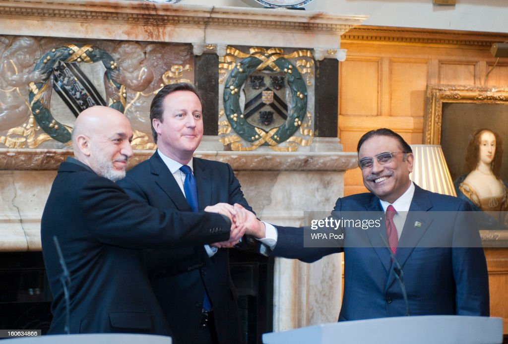 Prime Minister <a gi-track='captionPersonalityLinkClicked' href=/galleries/search?phrase=David+Cameron+-+Politician&family=editorial&specificpeople=227076 ng-click='$event.stopPropagation()'>David Cameron</a> hosts a trilateral meeting with President <a gi-track='captionPersonalityLinkClicked' href=/galleries/search?phrase=Hamid+Karzai&family=editorial&specificpeople=121540 ng-click='$event.stopPropagation()'>Hamid Karzai</a> of Afghanistan (L) and President Asif Ali Zardari of Pakistan (R) at the Prime Minister's country home of Chequers on February 4, 2013 in Ellesborough, England. Pakistan's President Asif Ali Zardari and Afghanistan's President <a gi-track='captionPersonalityLinkClicked' href=/galleries/search?phrase=Hamid+Karzai&family=editorial&specificpeople=121540 ng-click='$event.stopPropagation()'>Hamid Karzai</a> have travelled to the UK to meet the British Prime Minister who instigated these trilateral talks last year. The discussions are due to focus on cross border security and methods to engage the Taliban in effective peace talks.
