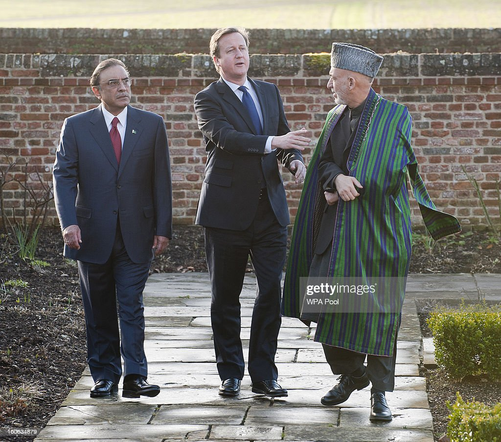 Prime Minister David Cameron hosts a trilateral meeting with President Hamid Karzai of Afghanistan (R) and President Asif Ali Zardari of Pakistan (L) at the Prime Minister's country home of Chequers on February 4, 2013 in Ellesborough, England. Pakistan's President Asif Ali Zardari and Afghanistan's President Hamid Karzai have travelled to the UK to meet the British Prime Minister who instigated these trilateral talks last year. The discussions are due to focus on cross border security and methods to engage the Taliban in effective peace talks.