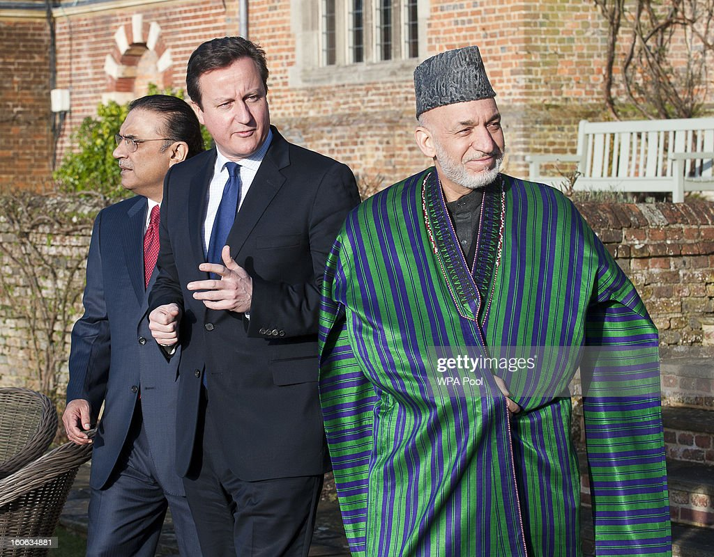 Prime Minister <a gi-track='captionPersonalityLinkClicked' href=/galleries/search?phrase=David+Cameron+-+Politician&family=editorial&specificpeople=227076 ng-click='$event.stopPropagation()'>David Cameron</a> hosts a trilateral meeting with President <a gi-track='captionPersonalityLinkClicked' href=/galleries/search?phrase=Hamid+Karzai&family=editorial&specificpeople=121540 ng-click='$event.stopPropagation()'>Hamid Karzai</a> of Afghanistan (R) and President Asif Ali Zardari of Pakistan (L) at the Prime Minister's country home of Chequers on February 4, 2013 in Ellesborough, England. Pakistan's President Asif Ali Zardari and Afghanistan's President <a gi-track='captionPersonalityLinkClicked' href=/galleries/search?phrase=Hamid+Karzai&family=editorial&specificpeople=121540 ng-click='$event.stopPropagation()'>Hamid Karzai</a> have travelled to the UK to meet the British Prime Minister who instigated these trilateral talks last year. The discussions are due to focus on cross border security and methods to engage the Taliban in effective peace talks.