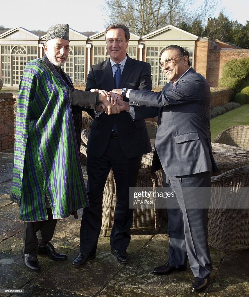 Prime Minister <a gi-track='captionPersonalityLinkClicked' href=/galleries/search?phrase=David+Cameron+-+Politico&family=editorial&specificpeople=227076 ng-click='$event.stopPropagation()'>David Cameron</a> hosts a trilateral meeting with President <a gi-track='captionPersonalityLinkClicked' href=/galleries/search?phrase=Hamid+Karzai&family=editorial&specificpeople=121540 ng-click='$event.stopPropagation()'>Hamid Karzai</a> of Afghanistan (L) and President Asif Ali Zardari of Pakistan (R) at the Prime Minister's country home of Chequers on February 4, 2013 in Ellesborough, England. Pakistan's President Asif Ali Zardari and Afghanistan's President <a gi-track='captionPersonalityLinkClicked' href=/galleries/search?phrase=Hamid+Karzai&family=editorial&specificpeople=121540 ng-click='$event.stopPropagation()'>Hamid Karzai</a> have travelled to the UK to meet the British Prime Minister who instigated these trilateral talks last year. The discussions are due to focus on cross border security and methods to engage the Taliban in effective peace talks.
