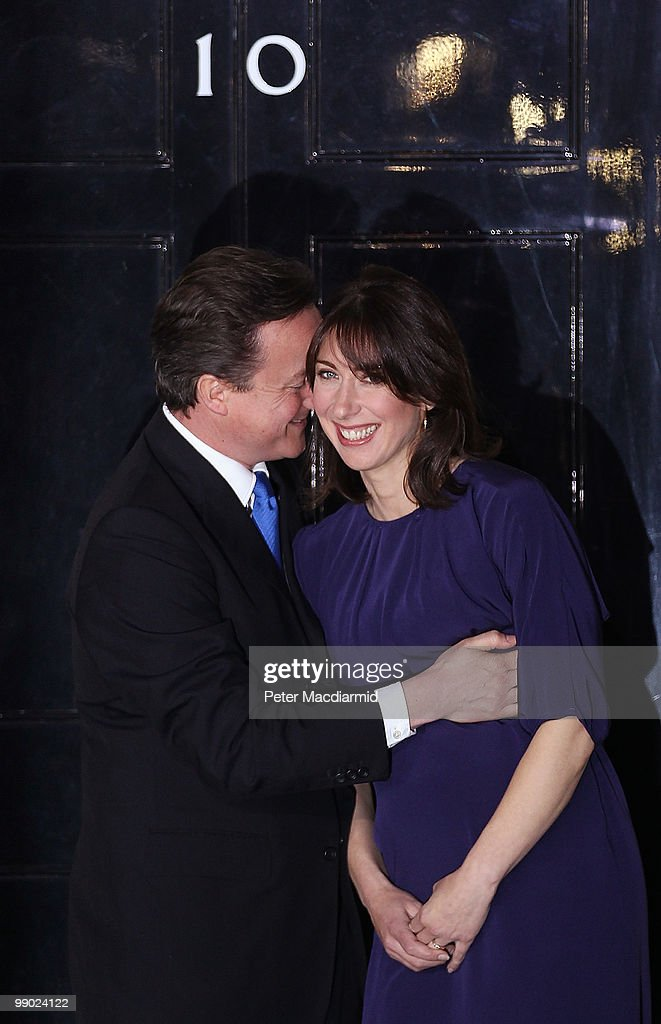 Prime Minister David Cameron hugs his wife Samantha on the steps of Number 10 Downing Street on May 11, 2010 in London, England. After five days of negotiation a Conservative and Liberal Democrat coalition government has been confirmed. Gordon Brown has resigned his position and David Cameron has become the new British Prime Minister.