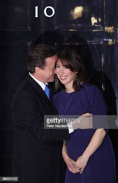 Prime Minister David Cameron hugs his wife Samantha on the steps of Number 10 Downing Street on May 11 2010 in London England After five days of...