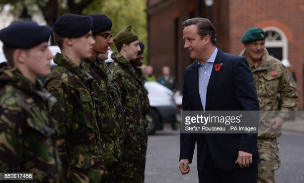 Prime Minister David Cameron inspects trainee Royal Marines in Downing Street central London after a team of Royal Marineacircs Charity Speedmarchers...