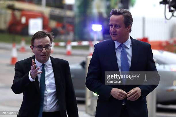 Prime Minister David Cameron is greeted by the head of Sky News John Ryley as he arrives to attend a SKY News interview with Faisal Islam followed by...
