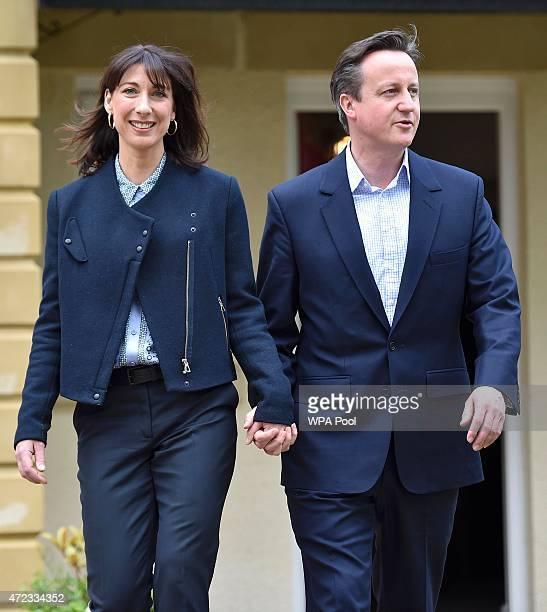 Prime Minister David Cameron is joined by his wife Samantha during a campaign visit to a home building scheme on May 6 2015 in Lancaster United...