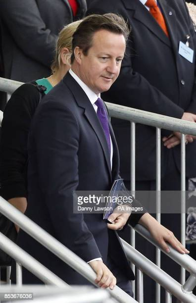 Prime Minister David Cameron is seen as Queen Elizabeth II officially named Royal Navy's new aircraft carrier HMS Queen Elizabeth during a visit to...