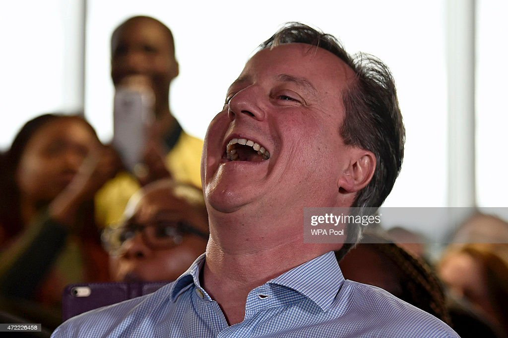 Prime Minister <a gi-track='captionPersonalityLinkClicked' href=/galleries/search?phrase=David+Cameron+-+Politician&family=editorial&specificpeople=227076 ng-click='$event.stopPropagation()'>David Cameron</a> laughs as London Mayor Boris Johnson speaks during an election rally on May 5, 2015 in Hendon, London, United Kingdom. Britain will go to the polls in a national election in just two days time.