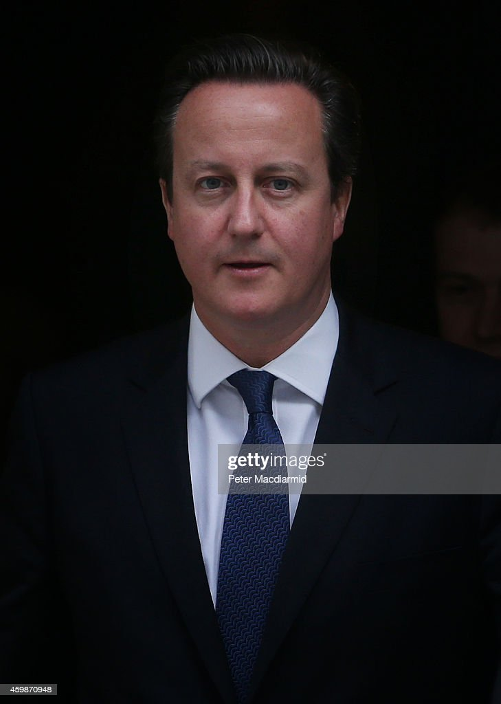 Prime Minister <a gi-track='captionPersonalityLinkClicked' href=/galleries/search?phrase=David+Cameron+-+Homme+politique&family=editorial&specificpeople=227076 ng-click='$event.stopPropagation()'>David Cameron</a> leaves Downing Street for Parliament on December 3, 2014 in London, England. Chancellor of the Exchequer George Osborne will deliver his Autumn statement to Parliament today.