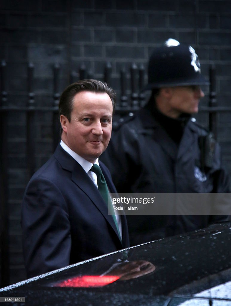 Prime Minister <a gi-track='captionPersonalityLinkClicked' href=/galleries/search?phrase=David+Cameron+-+Politician&family=editorial&specificpeople=227076 ng-click='$event.stopPropagation()'>David Cameron</a> leaves Downing Street for the Houses of Parliament on March 18, 2013 in London, England. A Press regulation deal has been agreed today by Conservatives, Labour and Lib Dems following a call for reform in the wake of Lord Justice Leveson's inquiry into press ethics and phone hacking.