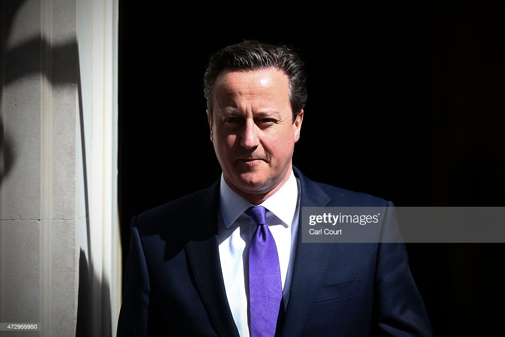 Prime Minister <a gi-track='captionPersonalityLinkClicked' href=/galleries/search?phrase=David+Cameron+-+Politician&family=editorial&specificpeople=227076 ng-click='$event.stopPropagation()'>David Cameron</a> leaves Downing Street on May 11, 2015 in London, England. Prime Minister <a gi-track='captionPersonalityLinkClicked' href=/galleries/search?phrase=David+Cameron+-+Politician&family=editorial&specificpeople=227076 ng-click='$event.stopPropagation()'>David Cameron</a> continued to announce his new cabinet with many ministers keeping their old positions.