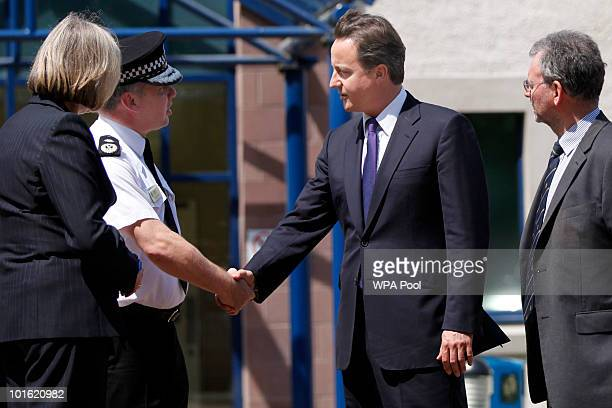 Prime Minister David Cameron leaves Workington Police Station following a visit with Home Secretary Theresa May and Craig Mackey the Chief Constable...
