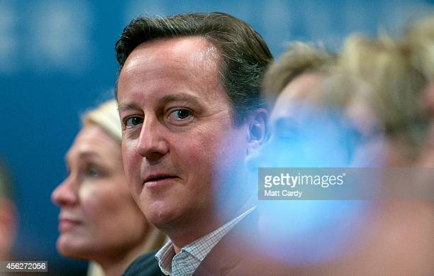 Prime Minister David Cameron listens to Leader of the House of Commons William Hague addressing delegates at the Conservative party conference for...