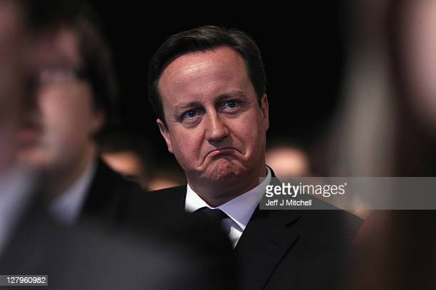 Prime Minister David Cameron listens to the Mayor of London Boris Johnson deliver his speech to delegates at the Conservative Party Conference on...