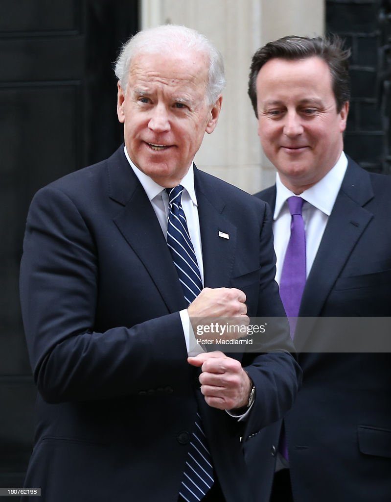Prime Minister <a gi-track='captionPersonalityLinkClicked' href=/galleries/search?phrase=David+Cameron+-+Politician&family=editorial&specificpeople=227076 ng-click='$event.stopPropagation()'>David Cameron</a> (R) looks on as US Vice President Joe Biden gestures to reporters as he leaves Downing Street on February 5, 2013 in London, England. The Vice President has also met with German and French leaders during his visit to Europe.