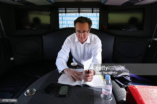 Prime Minister David Cameron looks up as he works on a speech on the Conservative election campaign bus on April 17 2015 near Builth Wells Wales The...