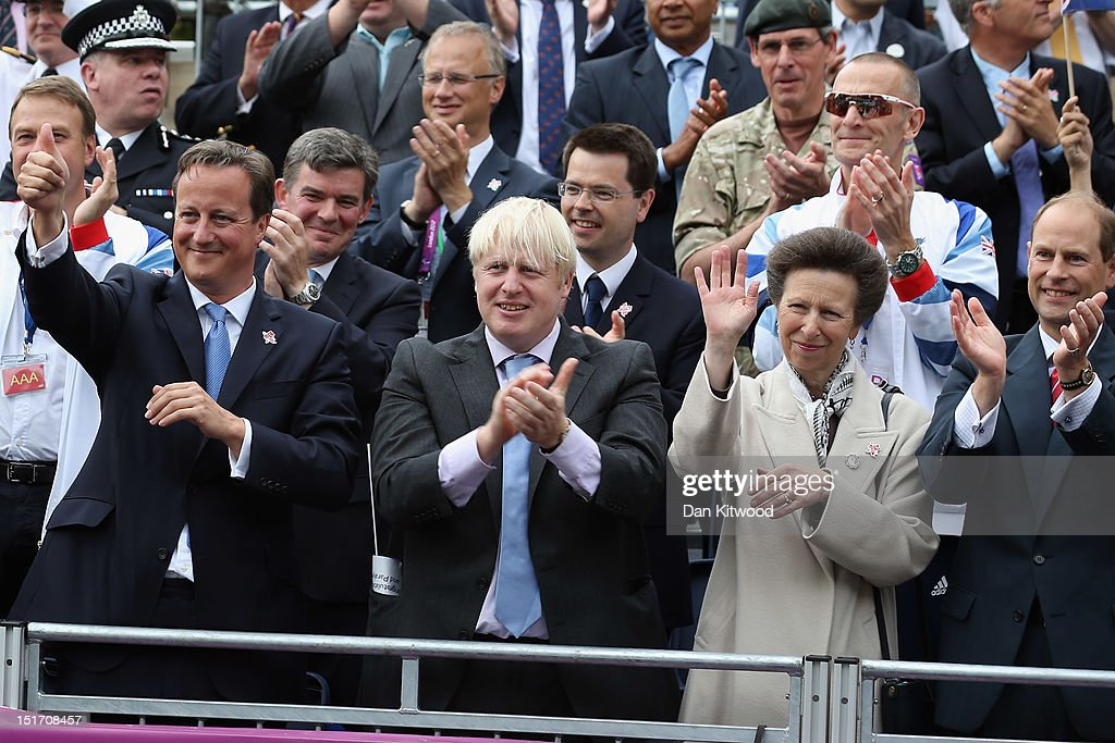 Prime Minister <a gi-track='captionPersonalityLinkClicked' href=/galleries/search?phrase=David+Cameron+-+Politician&family=editorial&specificpeople=227076 ng-click='$event.stopPropagation()'>David Cameron</a>, Mayor of London <a gi-track='captionPersonalityLinkClicked' href=/galleries/search?phrase=Boris+Johnson&family=editorial&specificpeople=209016 ng-click='$event.stopPropagation()'>Boris Johnson</a>, Princess Anne, Princess Royal and Prince Edward, Earl of Wessex wave to the athletes during the Olympics & Paralympics Team GB victory parade through central London on September 10, 2012 in London, England.