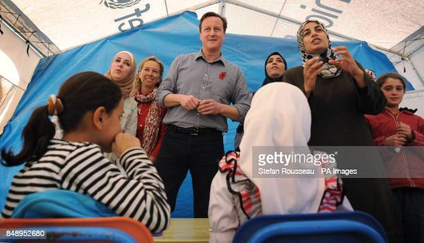 Prime Minister David Cameron meets children and teachers in a classroom at the Za'atri refugee camp near the Syrian Jordanian border where he met...