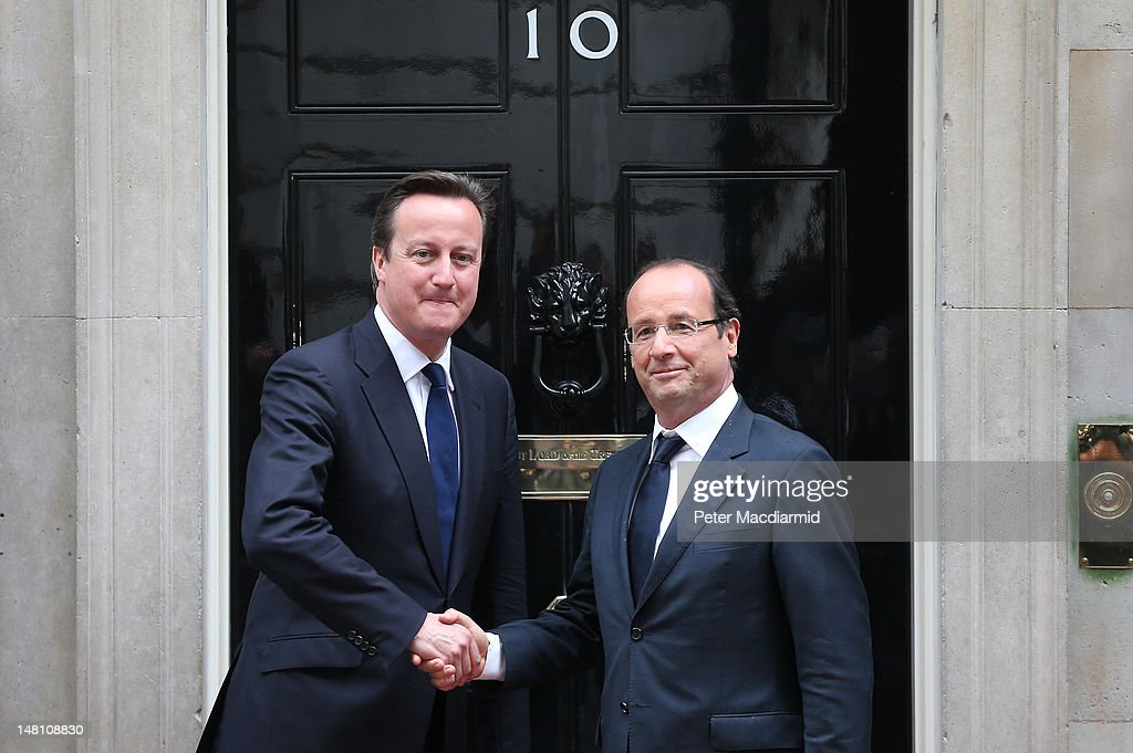 Prime Minister <a gi-track='captionPersonalityLinkClicked' href=/galleries/search?phrase=David+Cameron+-+Politician&family=editorial&specificpeople=227076 ng-click='$event.stopPropagation()'>David Cameron</a> (L) meets French President Francois Hollande in Downing Street on July 10, 2012 in London, England. This is the French President's first official visit to the United Kingdom, during which he will attend meetings with British Prime Minister <a gi-track='captionPersonalityLinkClicked' href=/galleries/search?phrase=David+Cameron+-+Politician&family=editorial&specificpeople=227076 ng-click='$event.stopPropagation()'>David Cameron</a> and Queen Elizabeth II.