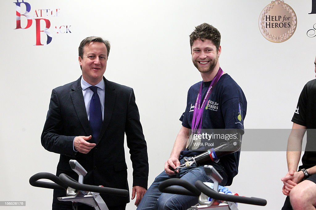Prime Minister David Cameron meets injured soldier and Paralympian JonAllan Butterworth at Tedworth House a Help for Heroes recovery centre on...
