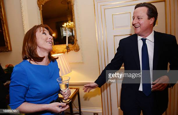 Prime Minister David Cameron meets Kay Burley of Sky News during a reception to celebrate the achievements of women in the media at 10 Downing St on...