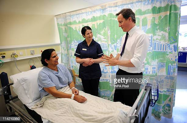 Prime Minister David Cameron meets knee patient Kulvinder Bhutta at Ealing Hospital before making a speech to doctors and nurses on NHS reform on May...