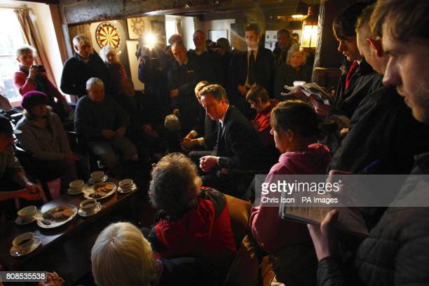 Prime Minister David Cameron meets residents of Pentewan at The Ship Inn during a visit to St Austell in Cornwall to see the impact of flooding...