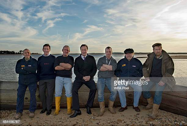 Prime Minister David Cameron meets some of the members of Wells Royal National Lifeboat Institution crew members Ray West Chris Hardy Allen Frary...