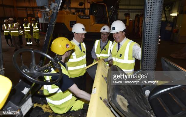 Prime Minister David Cameron meets staff at the Port of Tyne in Tyne and Wear as he visited the area while on the campaign trail for the upcoming...