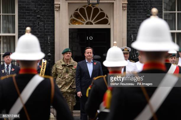 Prime Minister David Cameron meets veteran and serving Royal Marines in Downing Street central London after a team of Royal Marines Charity...