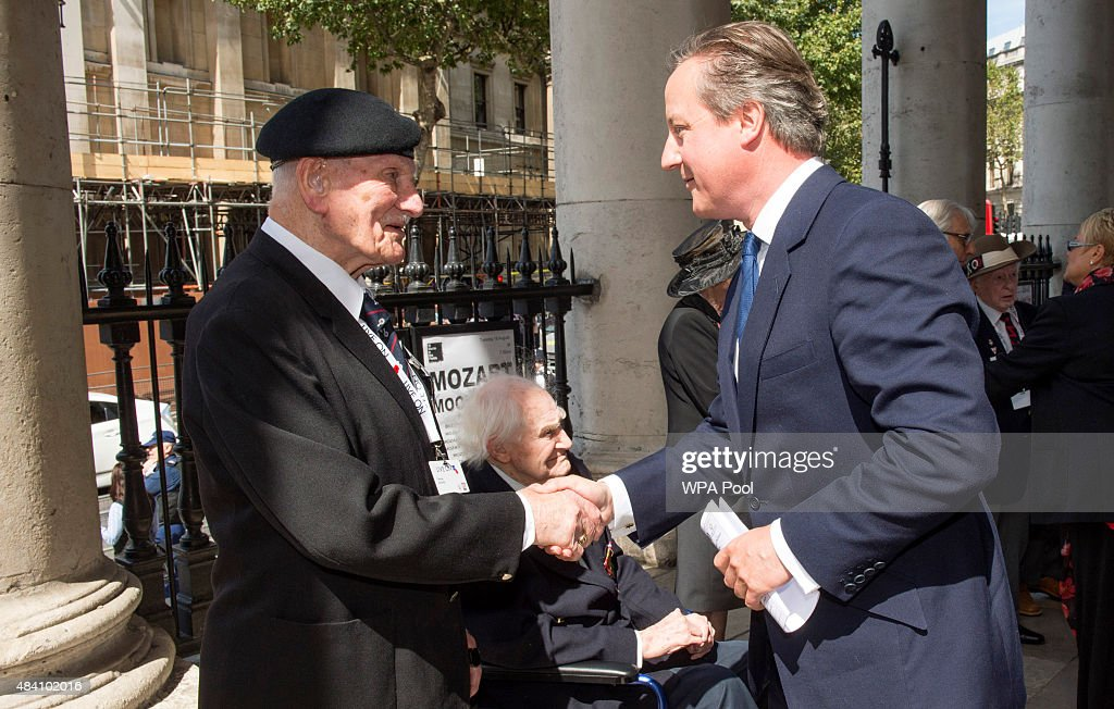 Prime Minister David Cameron meets Veterans during the 70th Anniversary commemorations of VJ Day (Victory over Japan) at St Martin-in-the-Fields Church on August 15, 2015 in London, England. The event marks the 70thanniversary of the surrender of Japanese Forces, bringing about the end of World War II. Queen Elizabeth II and Prince Philip, Duke of Edinburgh will join British Prime Minister David Cameron and former prisoners of war during services throughout the day as tributes are made to the the estimated 71,244 British and Commonwealth casualties of the Far East conflict. Japan formally surrendered on September 2, 1945 at a ceremony in Tokyo Bay on USS Missouri.