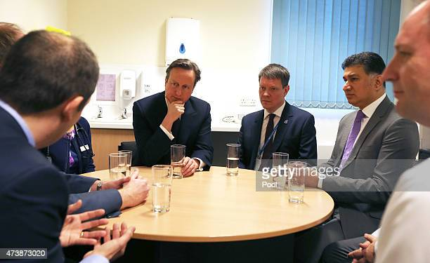 Prime Minister David Cameron meets with health staff at a GP Surgery on May 18 2015 in Birmingham England David Cameron renewed his preelection vow...