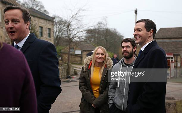 Prime Minister David Cameron Michelle Hardwick Kelvin Fletcher and the Chancellor Of The Exchequer George Osborne during a visit to the set of...