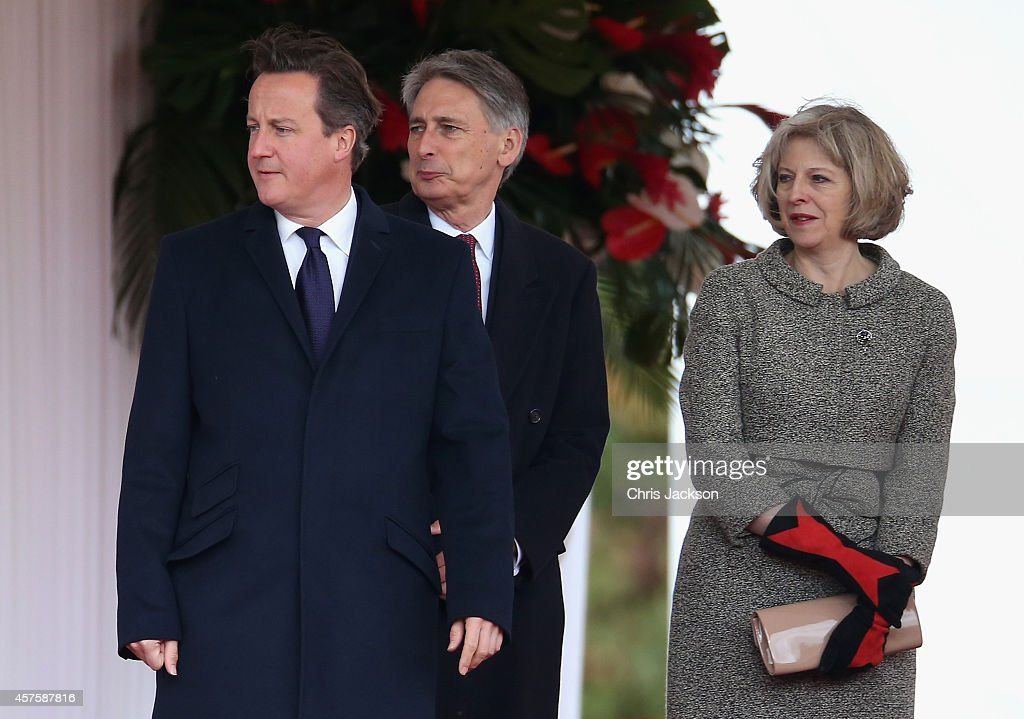 Prime Minister David Cameron, Philip Hammond and Theresa May during the official welcome for the President of Singapore Tony Tan Keng Yam (not seen) at Horseguards on October 21, 2014 in London, England.