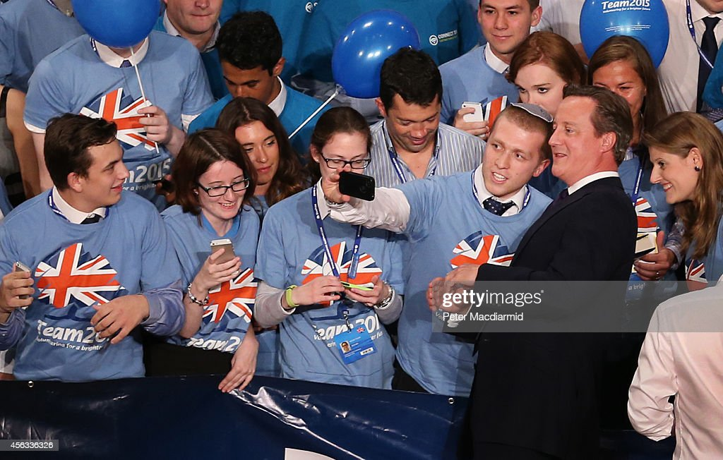 Prime Minister David Cameron poses for photographs with activists at the Conservative party conference on September 29 2014 in Birmingham England The...