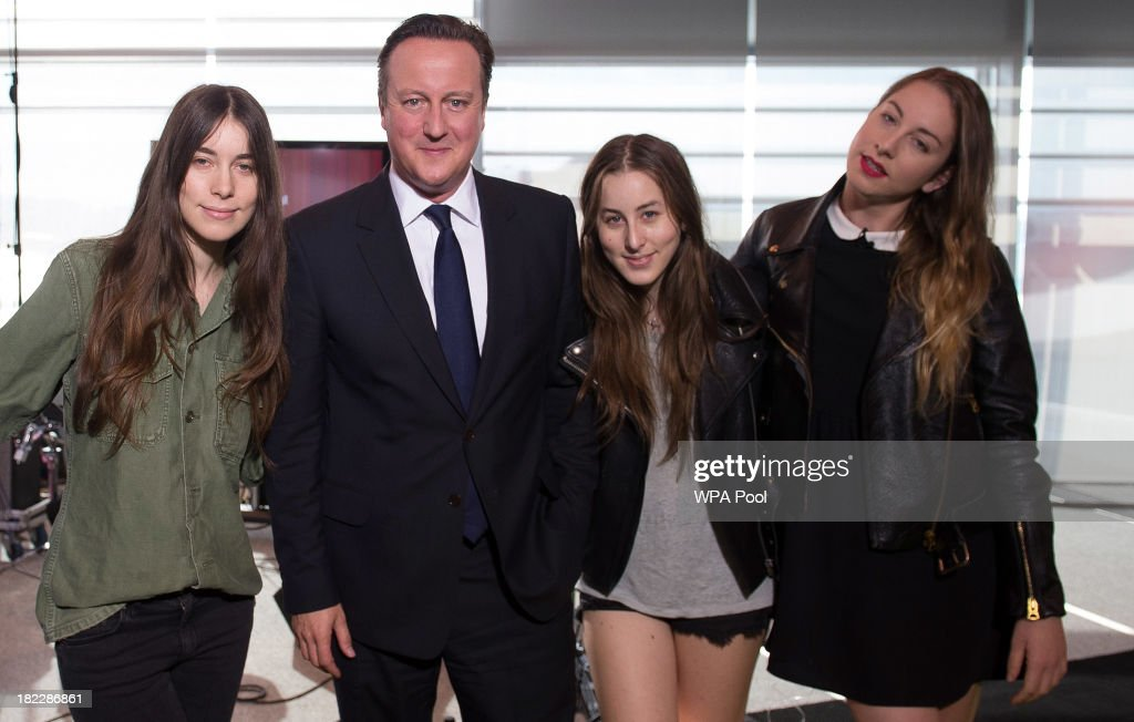 Prime Minister <a gi-track='captionPersonalityLinkClicked' href=/galleries/search?phrase=David+Cameron+-+Politician&family=editorial&specificpeople=227076 ng-click='$event.stopPropagation()'>David Cameron</a> poses with Este Haim, Danielle Haim and Alana Haim of the rock group Haim as they appear on the BBC current affairs programme, The Andrew Marr Show, before the start of the Conservative Party annual conference on September 29, 2013 in Manchester, England.