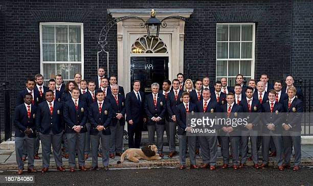 Prime Minister David Cameron poses with the British Lions rugby squad during an official reception at Downing Street on September 16 2013 in London...