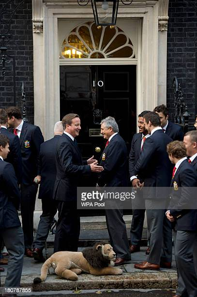 Prime Minister David Cameron poses with the British Lions rugby squad including Andy Irvine the Tour Manager during an official reception at Downing...
