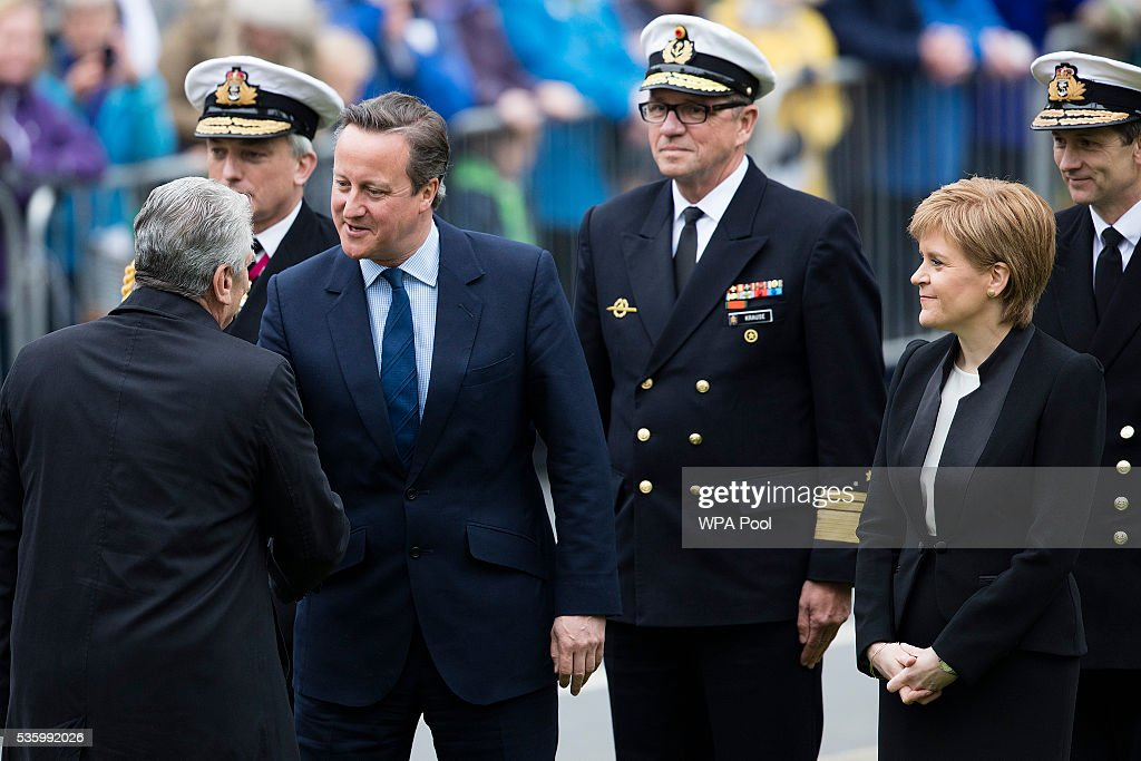 Prime Minister <a gi-track='captionPersonalityLinkClicked' href=/galleries/search?phrase=David+Cameron+-+Politico&family=editorial&specificpeople=227076 ng-click='$event.stopPropagation()'>David Cameron</a> shakes hands with German President <a gi-track='captionPersonalityLinkClicked' href=/galleries/search?phrase=Joachim+Gauck&family=editorial&specificpeople=2077888 ng-click='$event.stopPropagation()'>Joachim Gauck</a> (L) as First Minister of Scotland <a gi-track='captionPersonalityLinkClicked' href=/galleries/search?phrase=Nicola+Sturgeon&family=editorial&specificpeople=2582617 ng-click='$event.stopPropagation()'>Nicola Sturgeon</a> looks on during the commemorations of the 100th anniversary of the Battle of Jutland at St Magnus Cathedral on May 31, 2016 in Kirkwall, Scotland. The event marks the centenary of the largest naval battle of World War One where more than 6,000 Britons and 2,500 Germans died in the Battle of Jutland fought near the coast of Denmark on 31 May and 1 June 1916.
