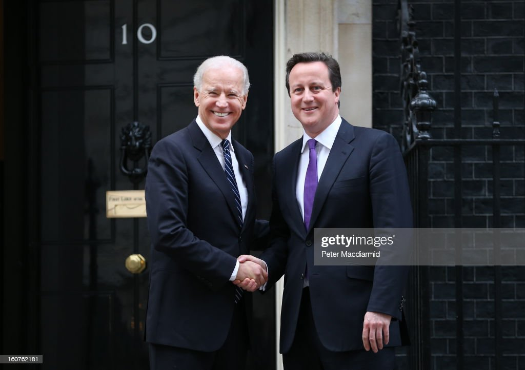 Prime Minister David Cameron (R) shakes hands with US Vice President Joe Biden as he leaves Downing Street on February 5, 2013 in London, England. The Vice President has also met with German and French leaders during his visit to Europe.