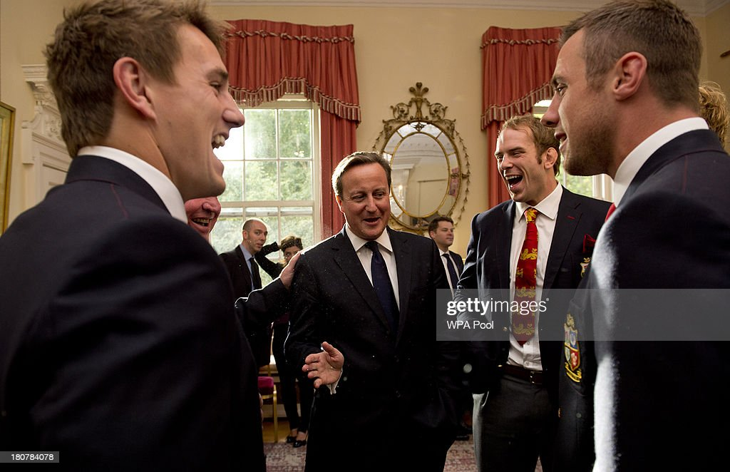 Prime Minister <a gi-track='captionPersonalityLinkClicked' href=/galleries/search?phrase=David+Cameron+-+Politician&family=editorial&specificpeople=227076 ng-click='$event.stopPropagation()'>David Cameron</a> shares a joke with Jonathan Davies, Alun Wyn Jones and <a gi-track='captionPersonalityLinkClicked' href=/galleries/search?phrase=Tommy+Bowe&family=editorial&specificpeople=556065 ng-click='$event.stopPropagation()'>Tommy Bowe</a> during an official reception at Downing Street on September 16, 2013 in London, England. The reception was to mark the British Lions victorious tour of Australia in the summer.
