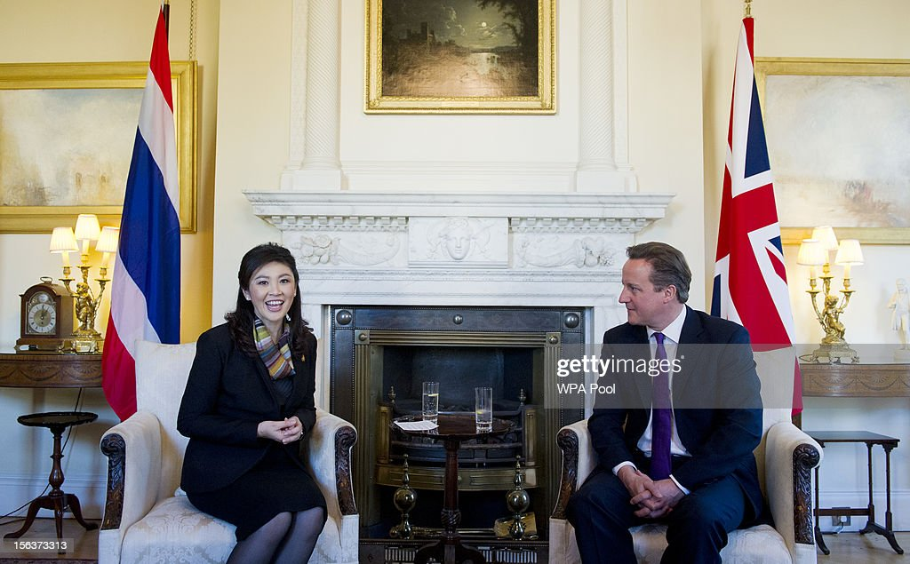 Prime Minister <a gi-track='captionPersonalityLinkClicked' href=/galleries/search?phrase=David+Cameron+-+Politician&family=editorial&specificpeople=227076 ng-click='$event.stopPropagation()'>David Cameron</a> sits with Thailand Prime Minister <a gi-track='captionPersonalityLinkClicked' href=/galleries/search?phrase=Yingluck+Shinawatra&family=editorial&specificpeople=787330 ng-click='$event.stopPropagation()'>Yingluck Shinawatra</a> inside N10 Downing Street on November 14, 2012 in London, England. The meeting is due to focus on trade relations, specifically increased cooperation on tourism, trade and investment.