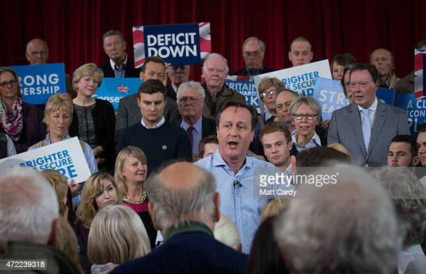 Prime Minister David Cameron speaks to party supporters gathered inside the Guildhall in St Ives on May 5 2015 in Cornwall England Britain will go to...