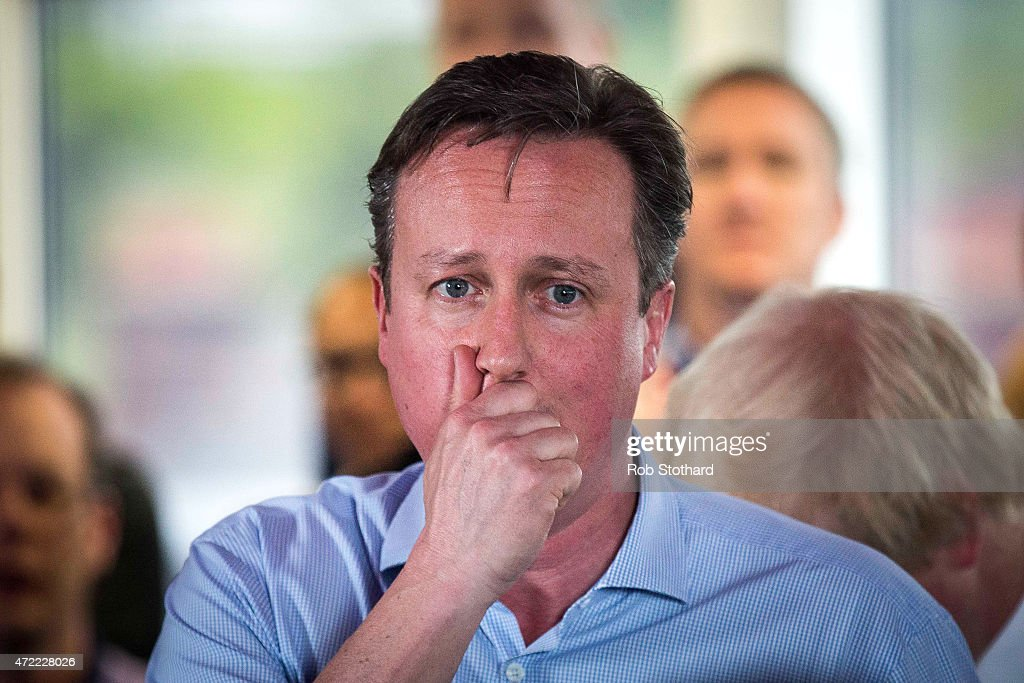 Prime Minister <a gi-track='captionPersonalityLinkClicked' href=/galleries/search?phrase=David+Cameron+-+Politician&family=editorial&specificpeople=227076 ng-click='$event.stopPropagation()'>David Cameron</a> speaks to staff at Utility Warehouse on May 5, 2015 in Hendon, England. Campaigning has intensified in the last few days before voters go to the polls in a general election on May 7, 2015.