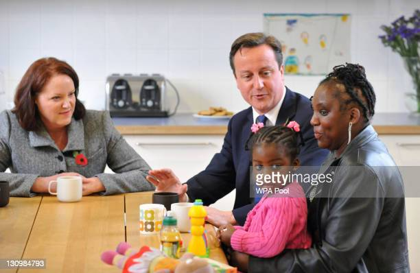 Prime Minister David Cameron speaks with adoptive mothers Tracy McLauchlan and Karen McKellar and her adoptive twoyearold daughter Angel during a...