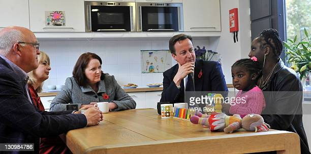 Prime Minister David Cameron speaks with foster carer Jim Bond and adoptive mothers Avril Head Tracy McLauchlan Karen McKellar and her adoptive...